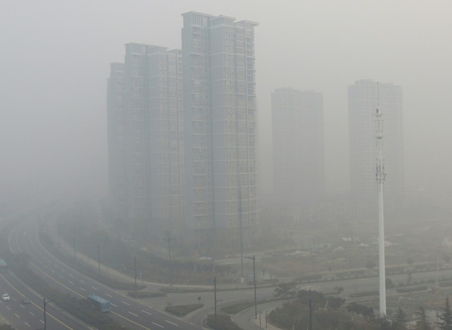Residential blocks are seen covered in smog in Lianyungang, east China
